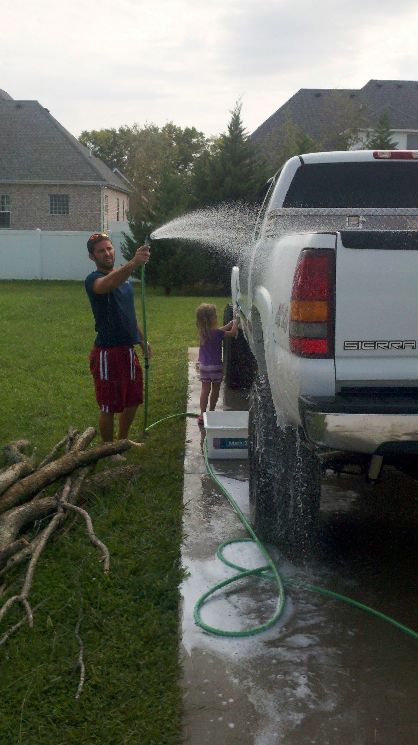 Allen and Tristyn washing his truck