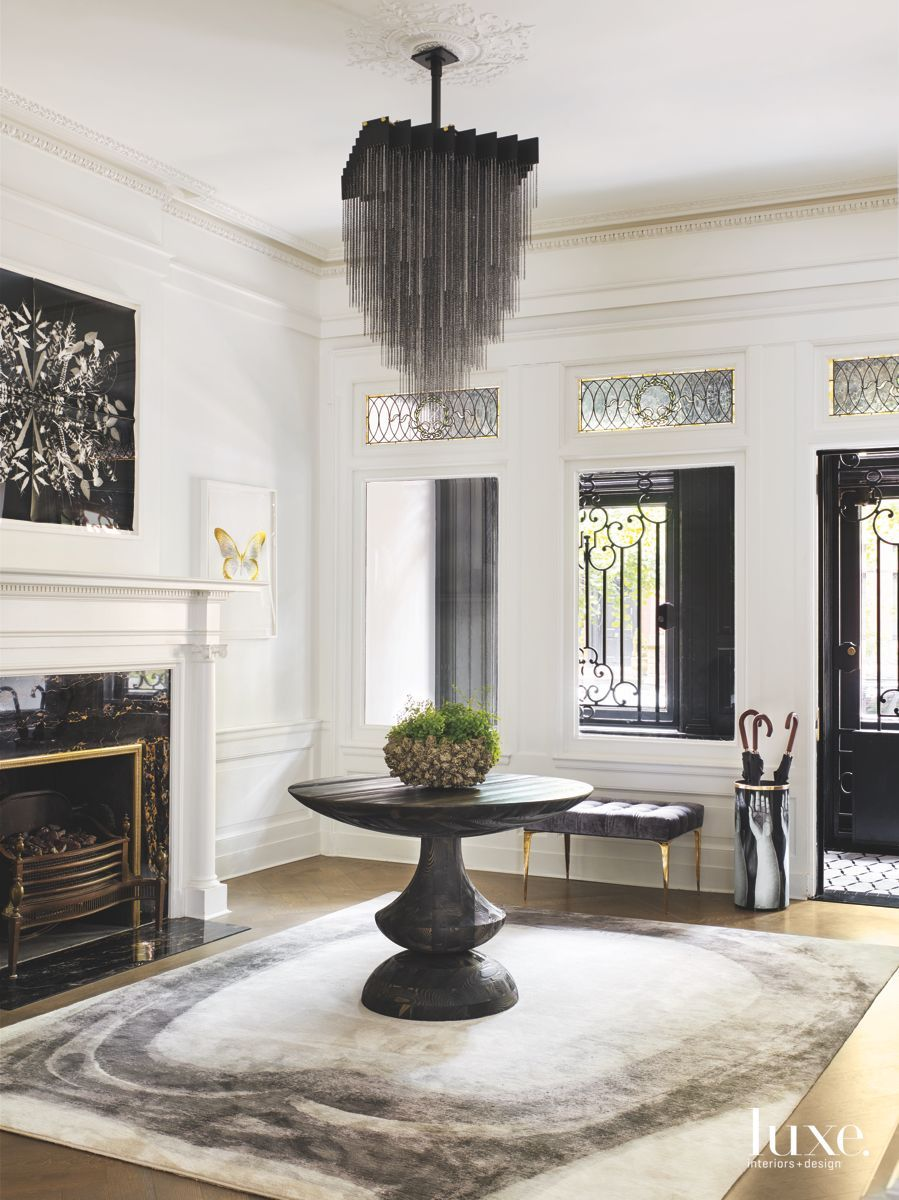 An updated layout and lively blend of furnishings allow a 19th ...