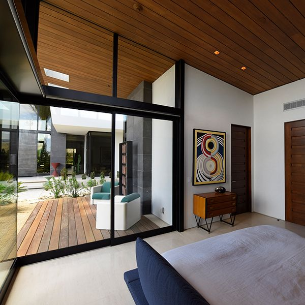 Pictured A Modern Style Bedroom In The Desert With Floor To