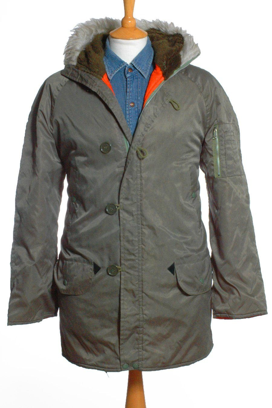 Green parka with orange zips