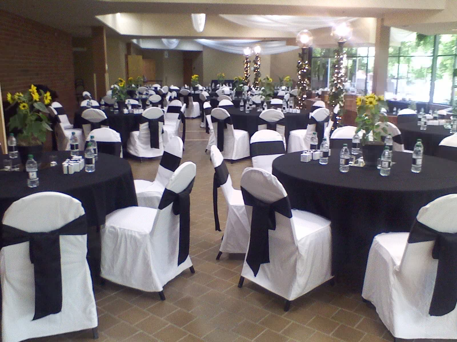 Folding chair covers with sash - Black Table Linens And White Chair Covers With Black Satin Sahses Traditional Bow At