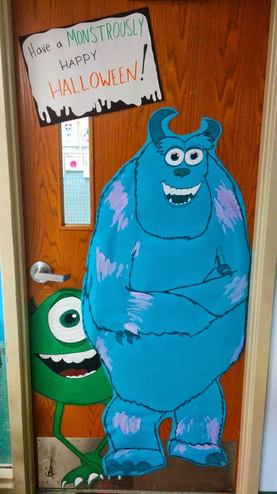 Classroom Halloween door decor, Monsters Inc. for fall or Halloween with Mike Wazowski and Sulley! #halloweenclassroomdoor Classroom Halloween door decor, Monsters Inc. for fall or Halloween with Mike Wazowski and Sulley! #falldoordecorationsclassroom