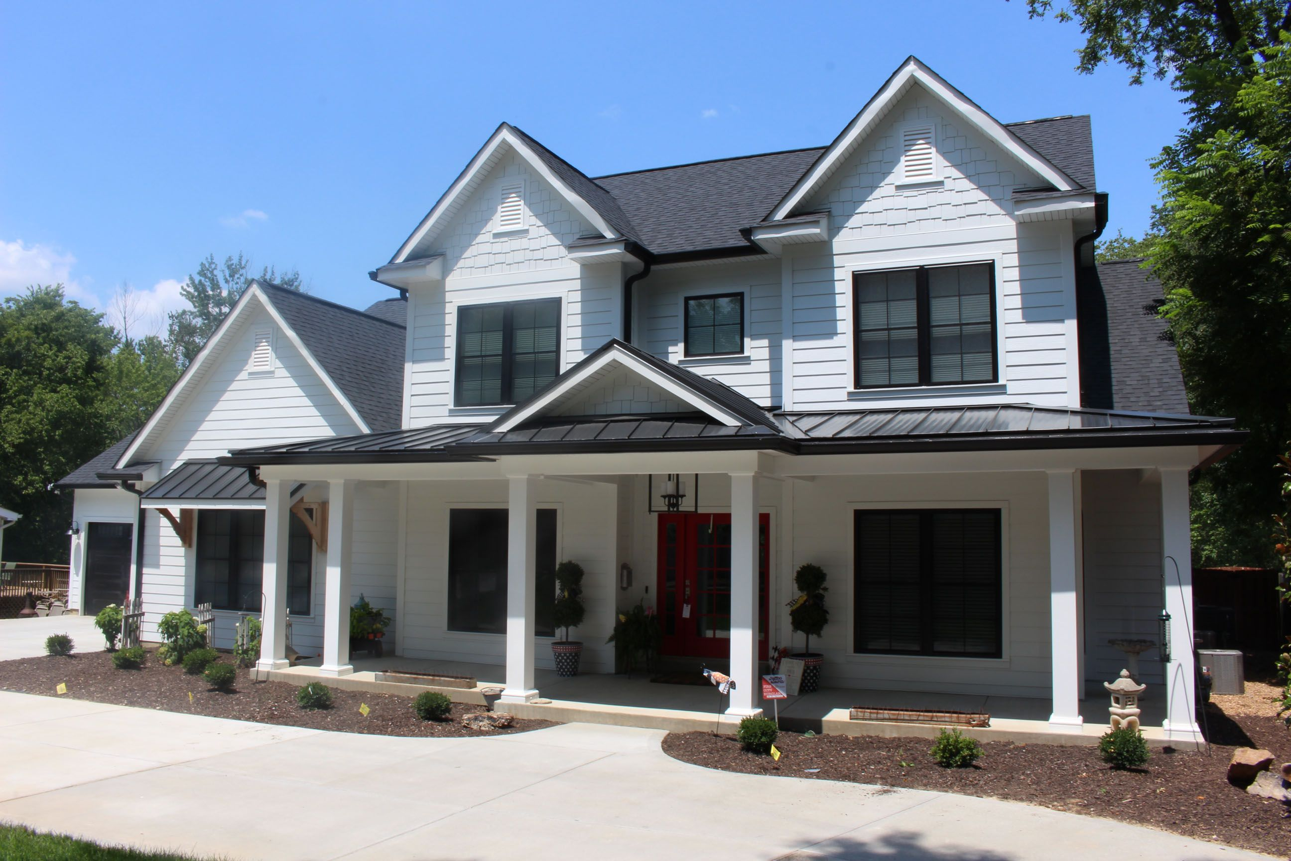 This is a beautiful Modern Farmhouse with James Hardie