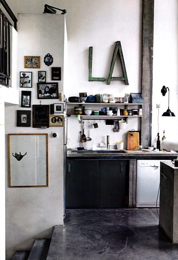 urban kitchen blacks and gray orderly and yet shuffled too