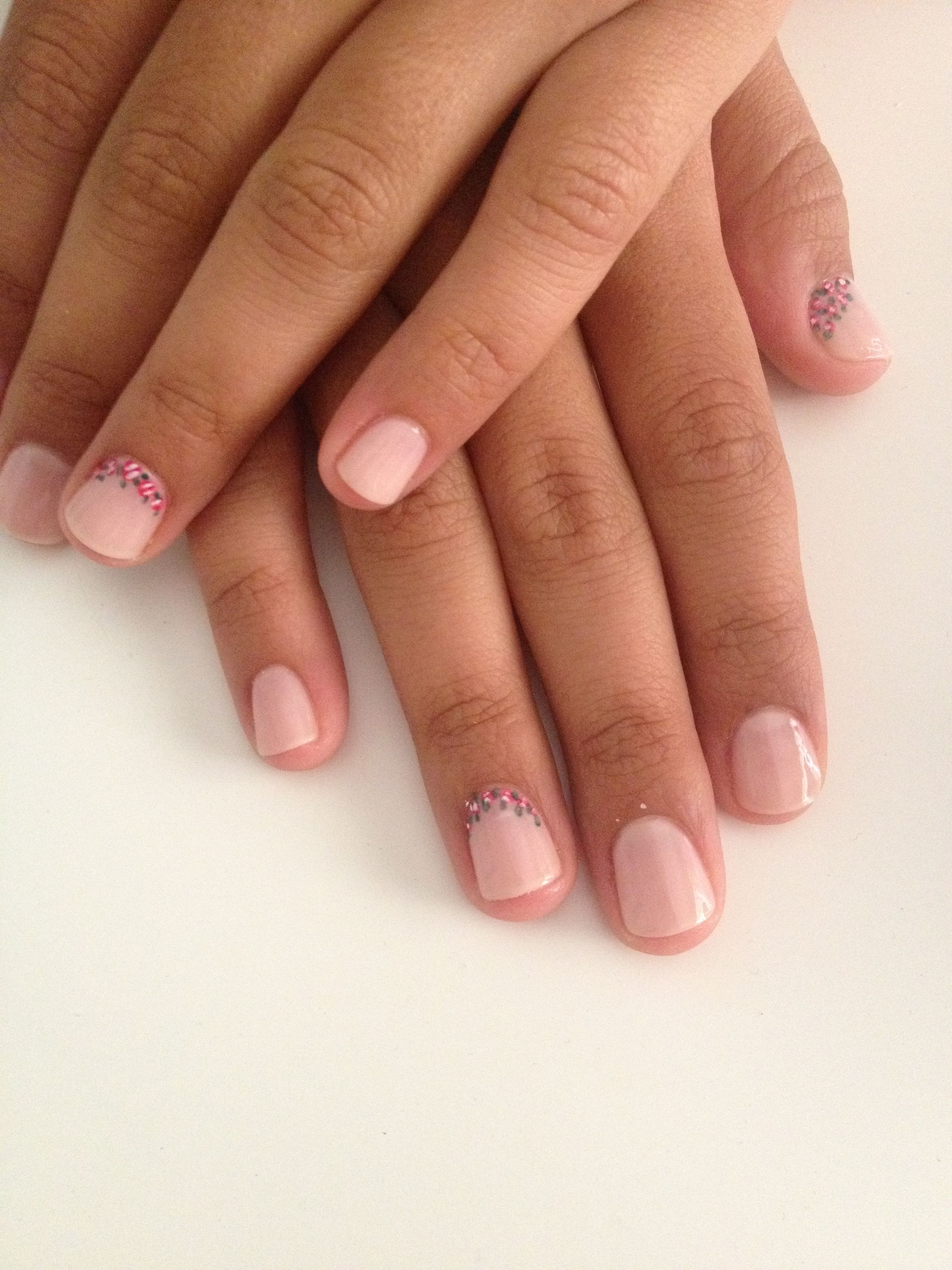 Nude colour nail polish with little flowers as a design nails