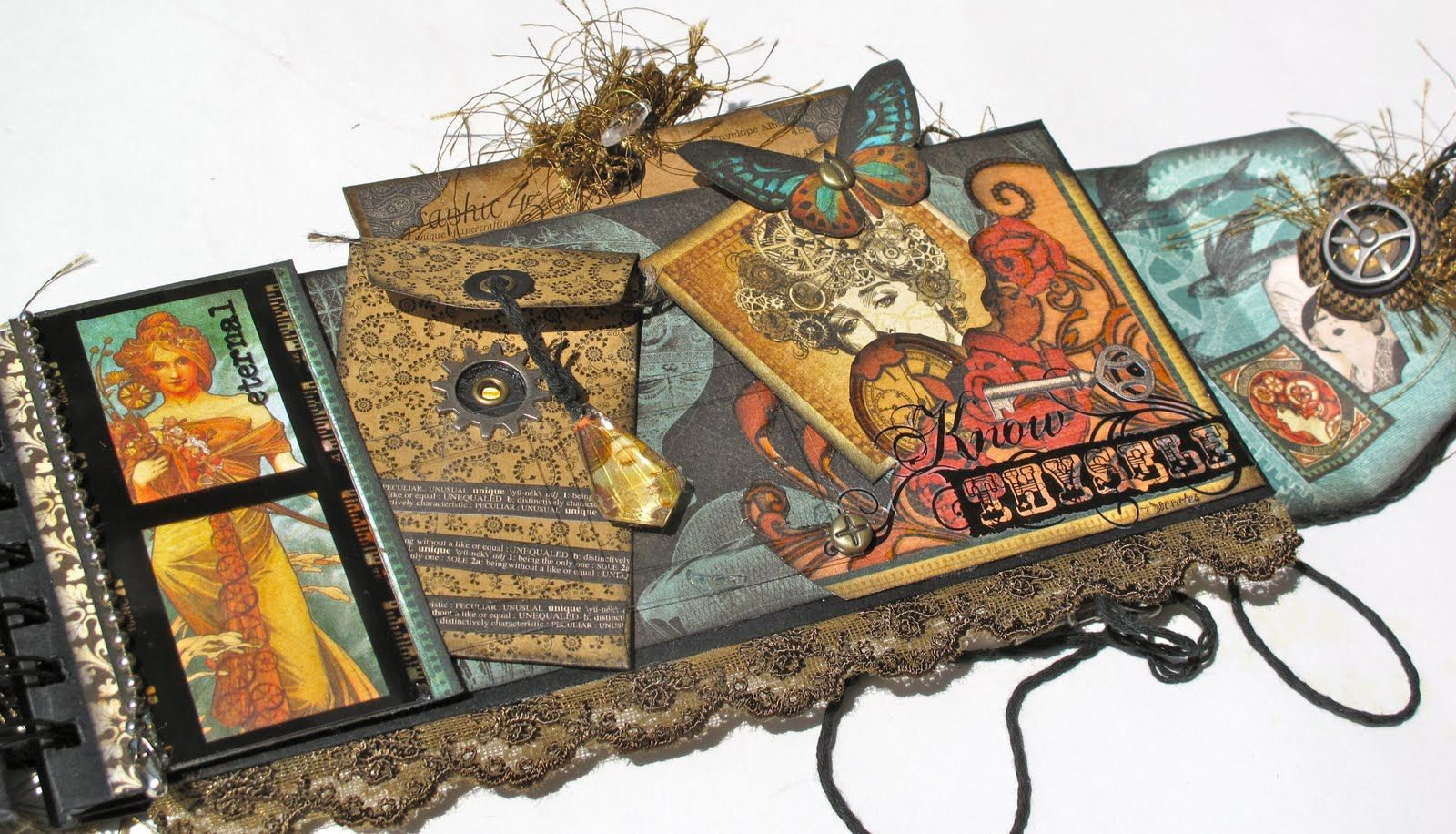 Tons of pockets and tags!    With A Grin: Graphic 45 Steampunk Debutante Policy Mini Album