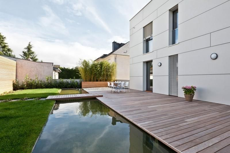 Fish pond design wooden deck in terrace house modern white house