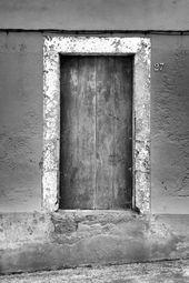 Wooden door concrete wall from Jan Bronze on canvas, wallpape …