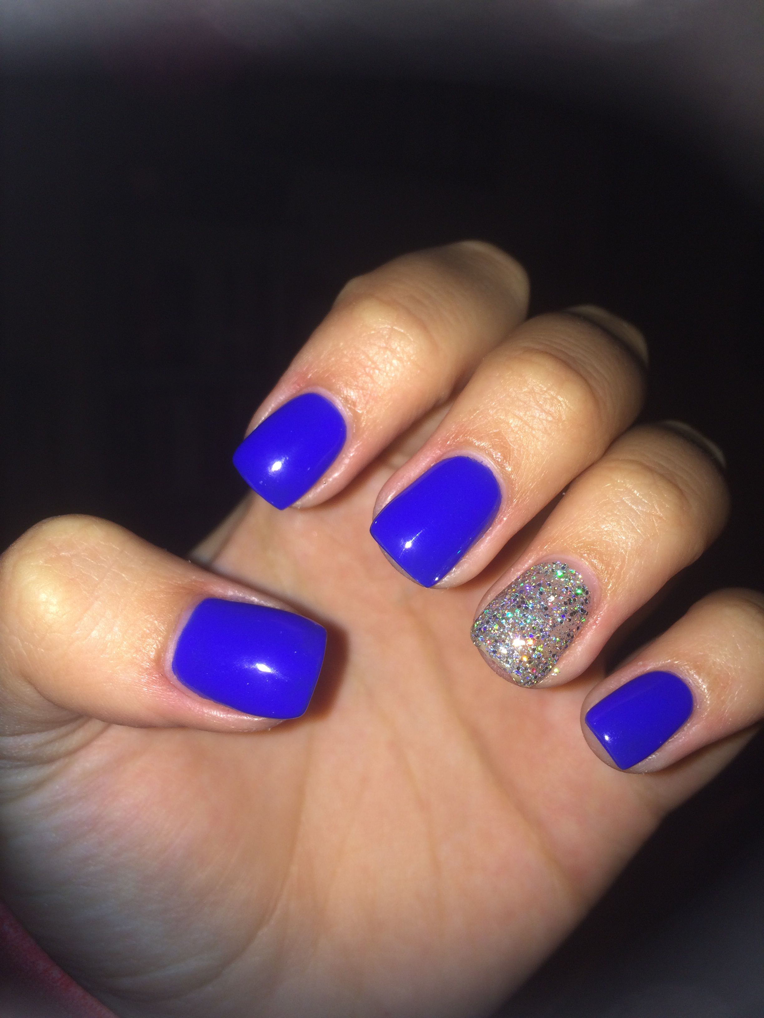 Short acrylic nails, royal blue with sparkle accent