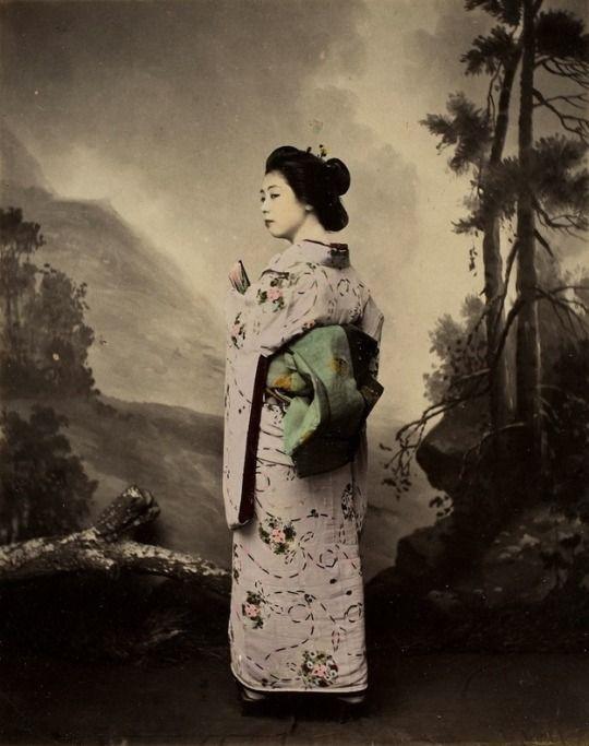 School of Yokohama - Geisha modelling in furisode - Hand colored albumen print - Japan - 1890s