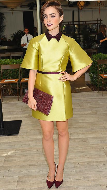 Lily Collins in a yellow mini dress with maroon accents