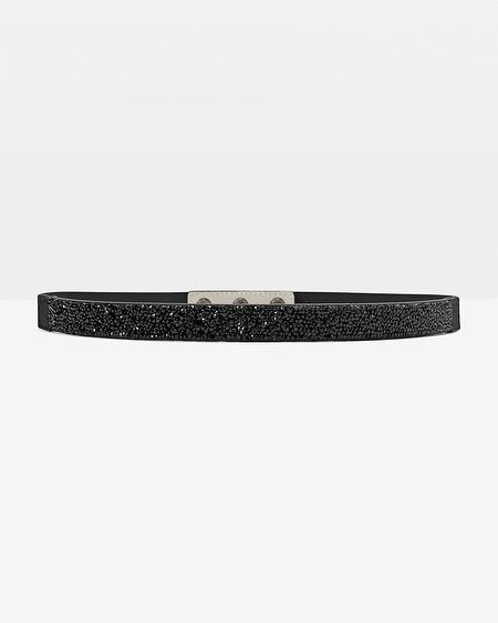 """Decadent black-rock crystals embellish this skinny belt. Stylist Note: Use this style to make a pretty sheath even prettier. Encrusted belt with elasticized back Sized at the waist, may be worn at the hip  Approx. 3/4"""" in width   Manmade materials/genuine leather   Imported"""