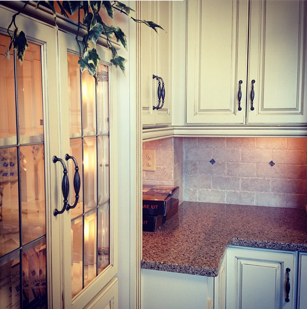 I'm liking the distressed off-white cabinets.   Kitchen ...
