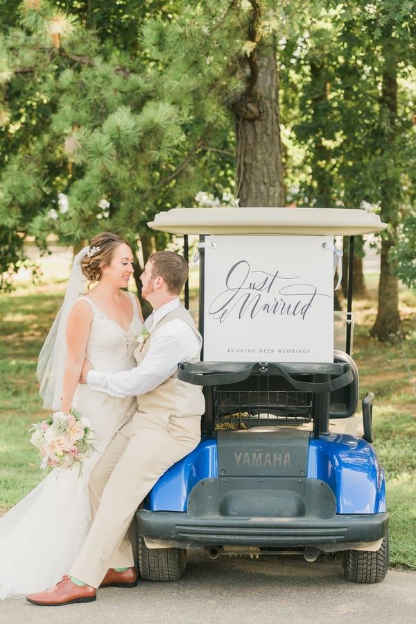 Bride and groom posing next to their golf cart that has a just ... on dinner dress, performance dress, scooter dress, boat dress, convertible dress, tank dress, tee dress, house dress, accessories dress,