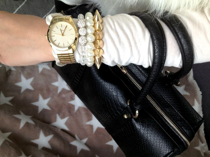 Black back with snake skin and gold details with matching accessories #black #back #gold #snakeskin #pearls #bracelets #watch #stud #spike