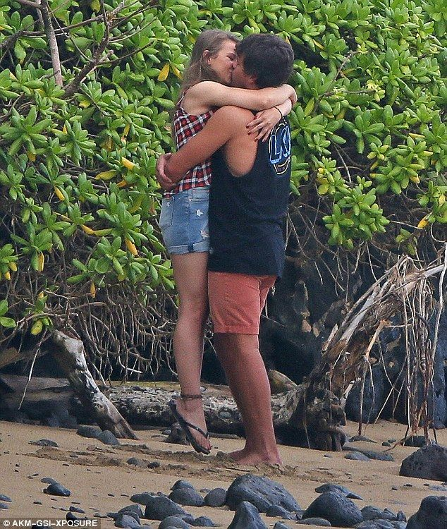 Close: Bindi Irwin and Chandler Powell enjoyed a tactile display during an appearance in tropical Hawaii, where they are currently enjoying a family holiday