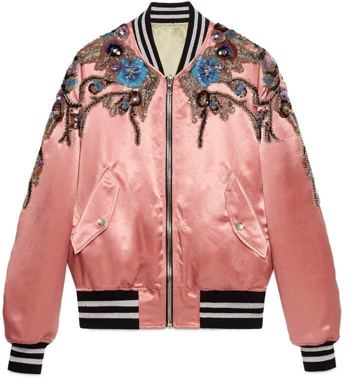 Reversible sequin acetate bomber. An iridescent acetate bomber jacket with  contrast ribbed knitted trim. The three-dimensional floral appliqués are…