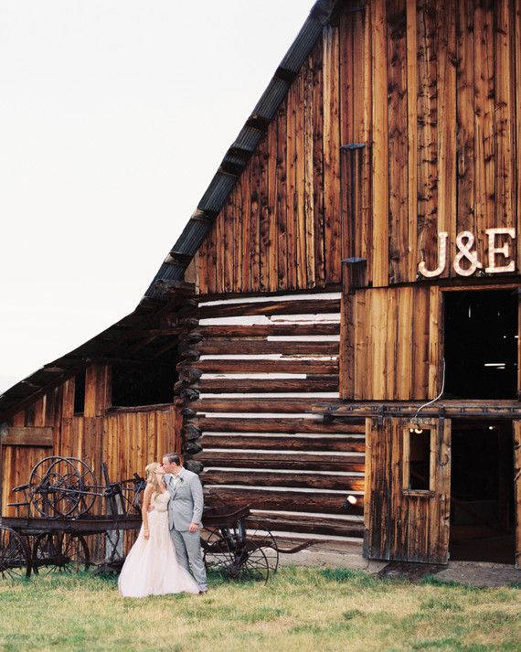 Using cardboard, bulbs, and silver spray paint, Erin crafted oversized letters and an ampersand to accent the barn's exterior.