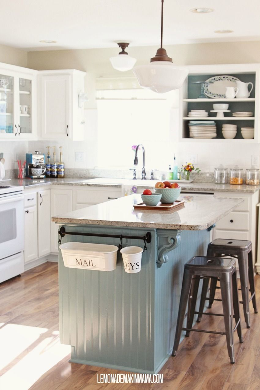 like the mix of white &blue-grey on cabinets in this country kitchen ...
