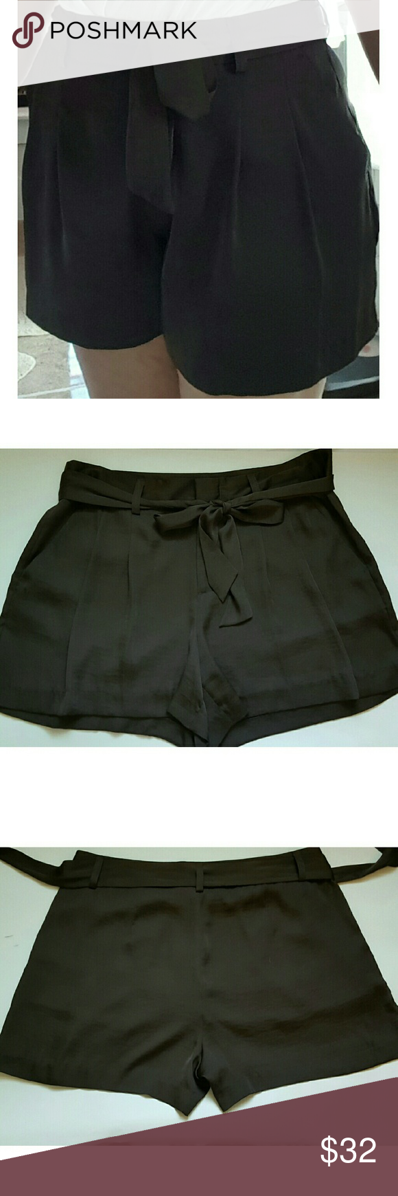 Vince Camuto belted shorts with pleas You will exude chic, laid-back style, with this VC shorts. With a relaxed fit through the legs, this piece is made if 109% polyester.  Machine washable. Vince Camuto Shorts