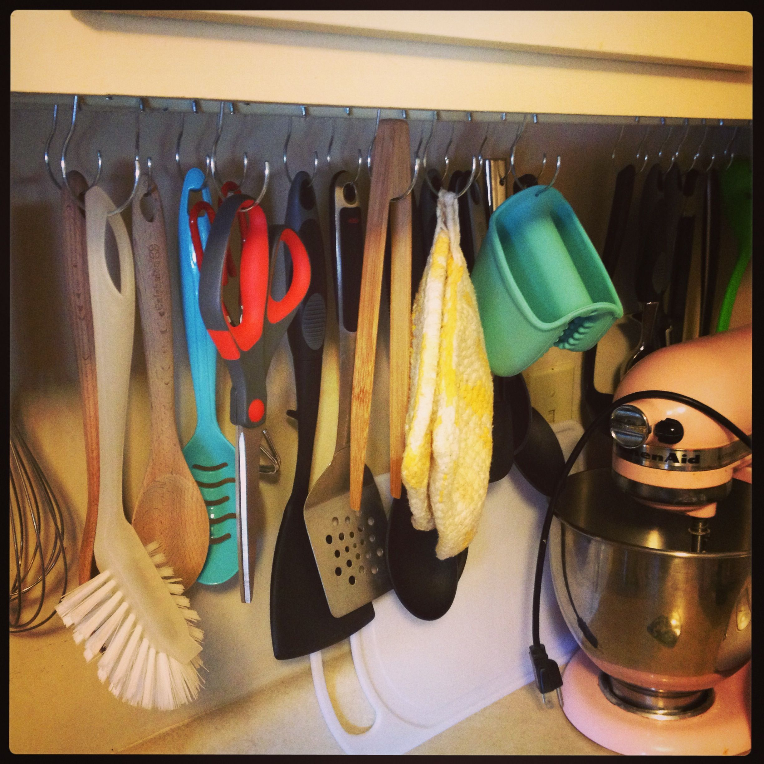 We Used Tension Rods To Hang Utensils Under Our Apartment S