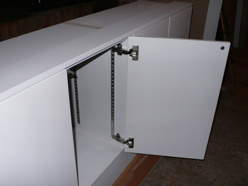 Take the old hard ware off wood putty up the holes install push to open latches modern feel using the old cabinets