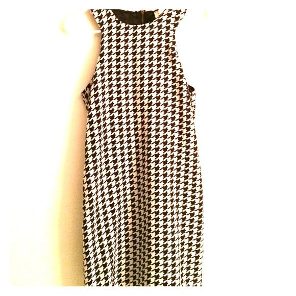 Houndstooth Dress Houndstooth dress. Perfect, fun pattern. Can be paired with a blazer or nothing at all. :) Dresses