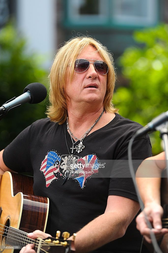 Joe Elliott of Def Leppard performs at 'Extra' at The Grove on June 1, 2012 in Los Angeles, California.