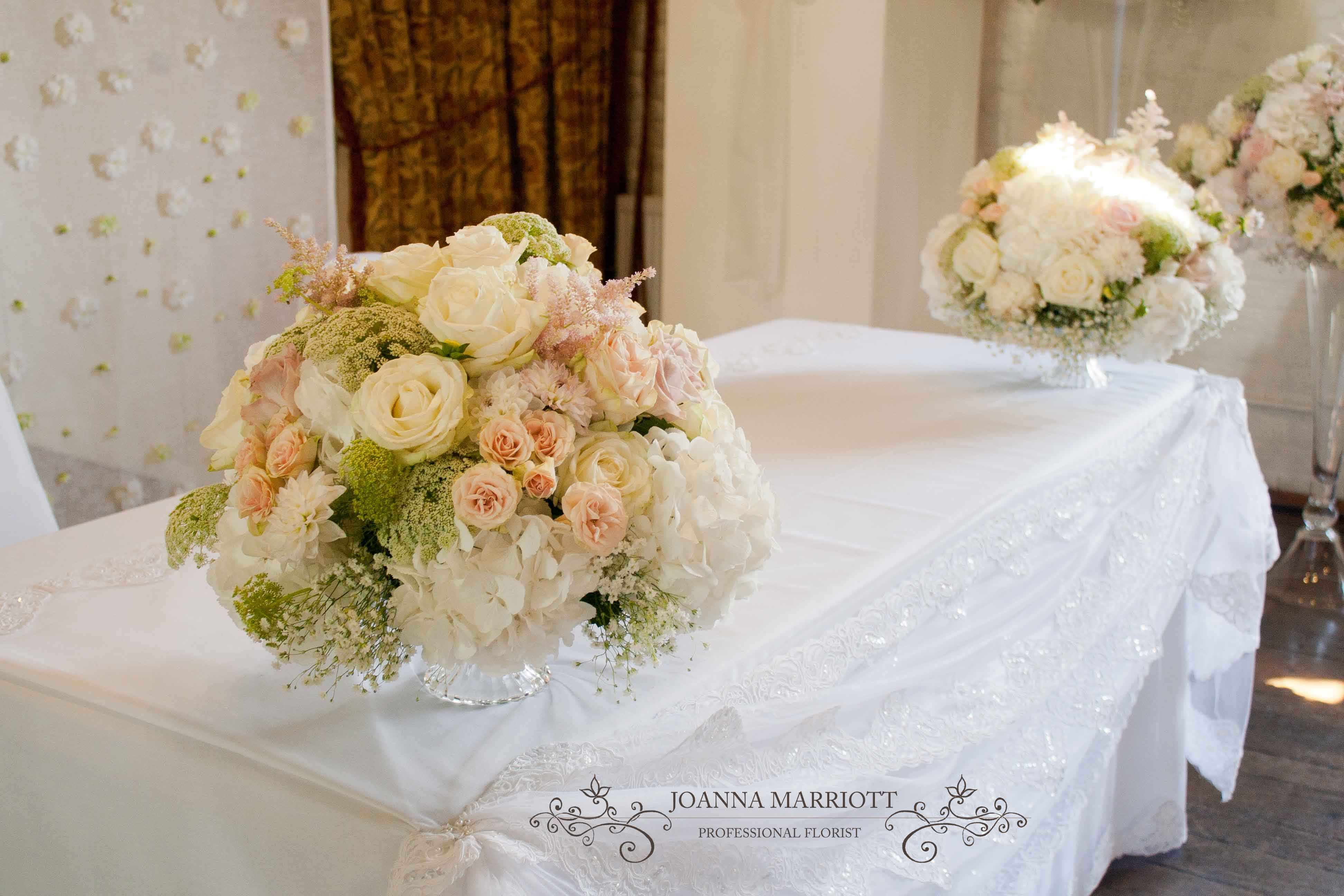 Pastel And Nude Wedding Theme Registry Table Flower Displays And