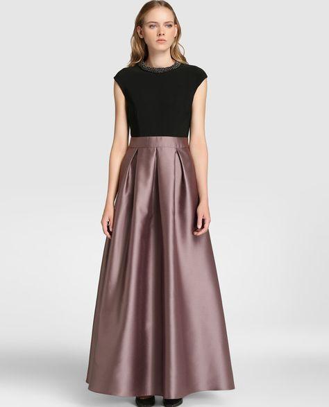 Vestido largo, con efecto top y falda. Cuerpo en color negro, de ...