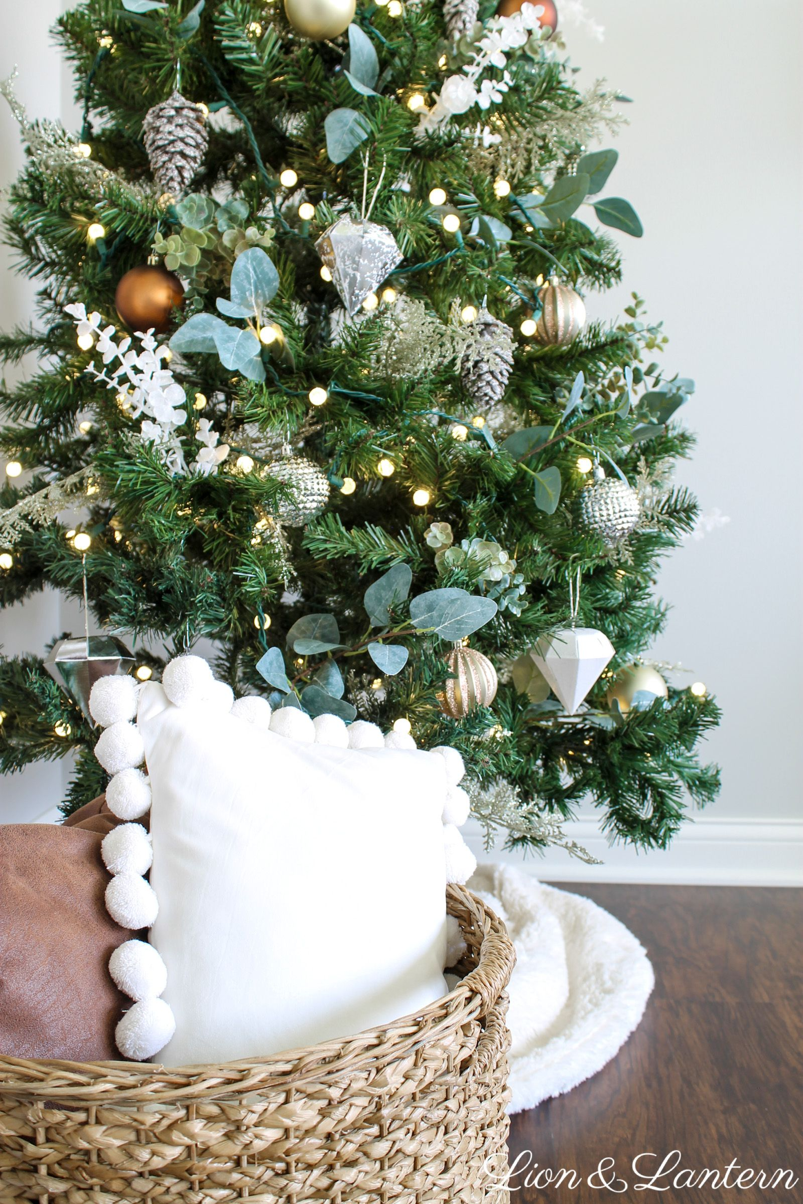 Who Says Christmas Trees Need To Cost A Fortune Dress Up A Simple Tree With Faux Eucalyptus Ste Rustic Christmas Diy Christmas Decor Diy Simple Christmas Tree
