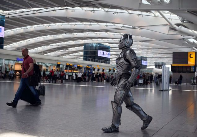 Doctor Who took over Heathrow Airport for its 50th anniversary, and there are some lovely photos of a Cyberman wandering the airport like a lost traveler. Terrorizing children, attacking author Jenny Colgan... and conducting the philharmonic orchestra.