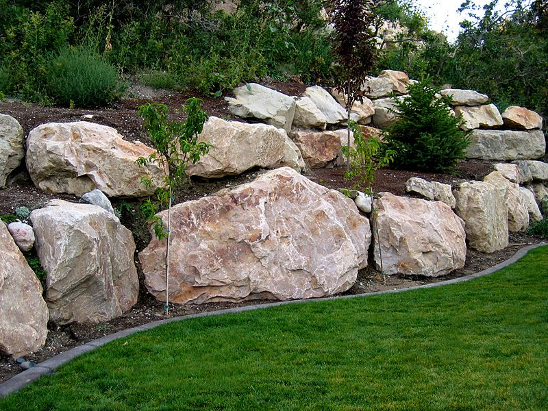 Boulder retaining wall offers the experience of 200 000 for Rock wall garden designs
