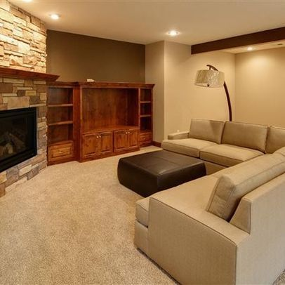 custom design wall unit next to corner fireplace/ sectional with ...
