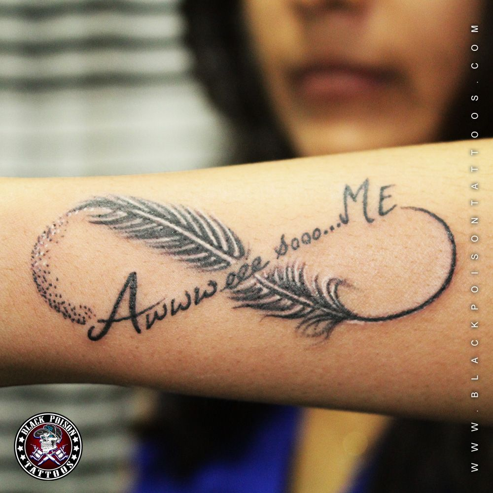 awesome feather tattoo in infinity with lettering can we
