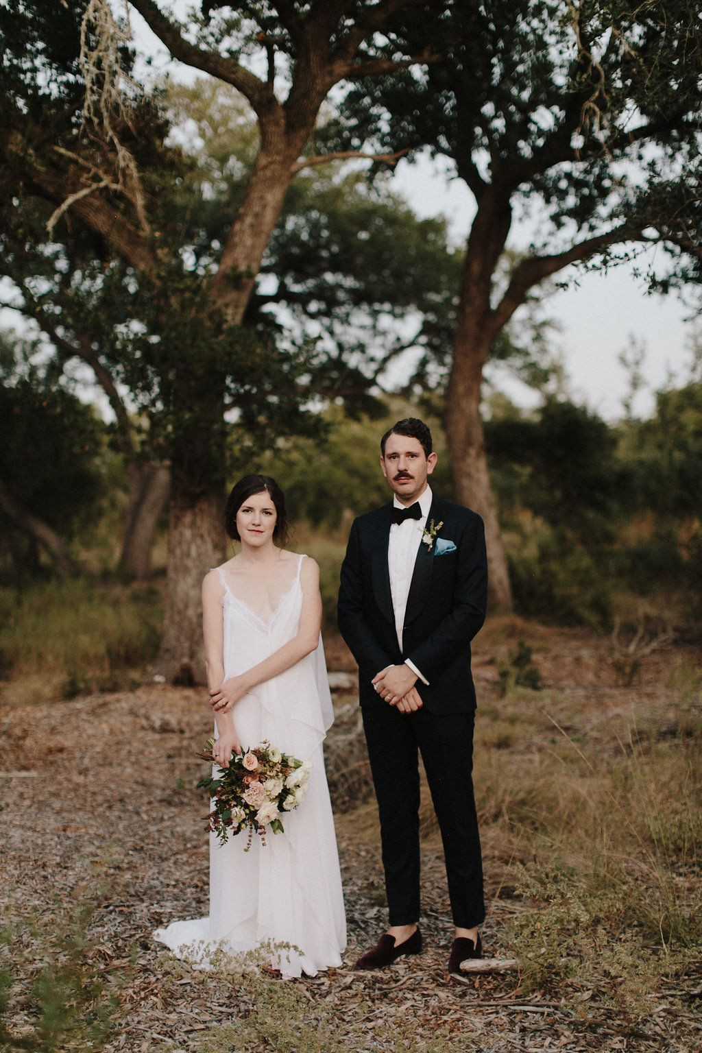Bohemian bridal gown and bouquet laid back texas hill country