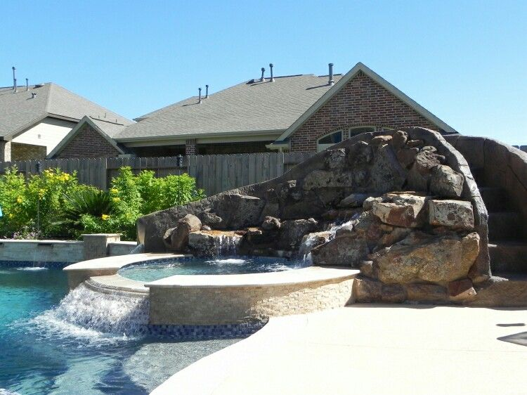 Slant Of Spillway Stone Tile And Water Color Swimming Pool