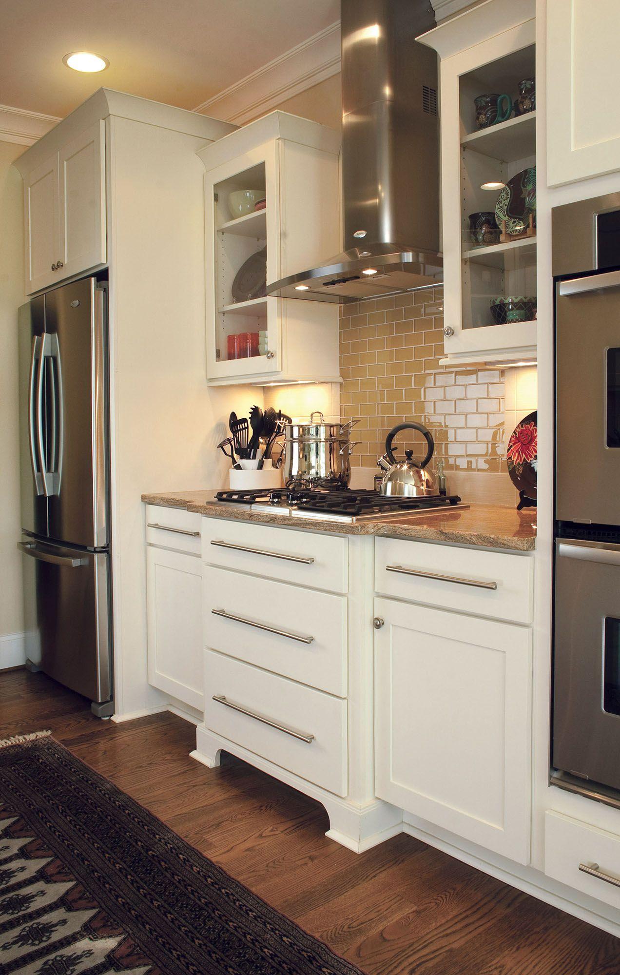 Beautifully designed open floor plan kitchen features painted shaker ...