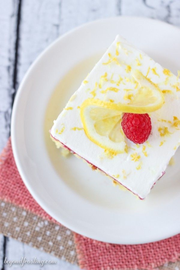 This Lemon Raspberry Poke Cake Is An Easy Lemon Cake Soaked In Sweetened Condensed Milk With A Fresh Easy Lemon Cake Recipe Lemon Cake Recipe Lemon Cake Easy