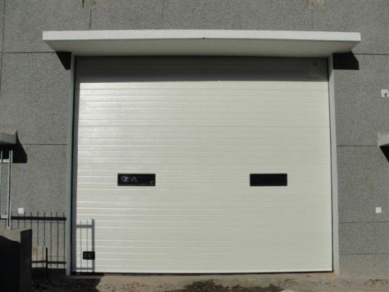 Toshi Automatic Systems Pvt Ltd Is One Of The Leading Insulated Sectional Door Panels Suppliers And Manufacturers Sectional Door Sectional Garage Doors Doors