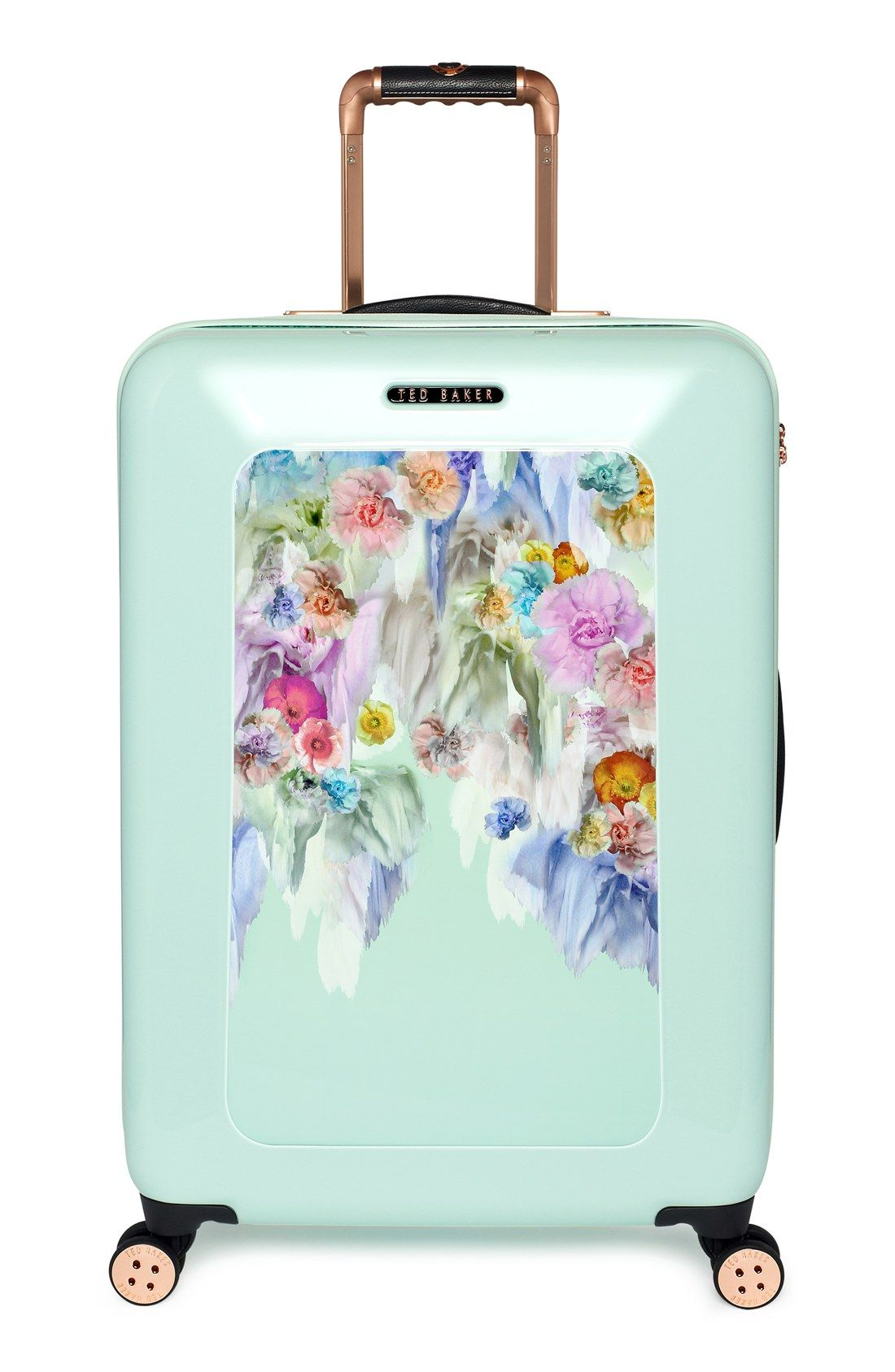 50632ba37ed23 Love the floral print on this mint luggage