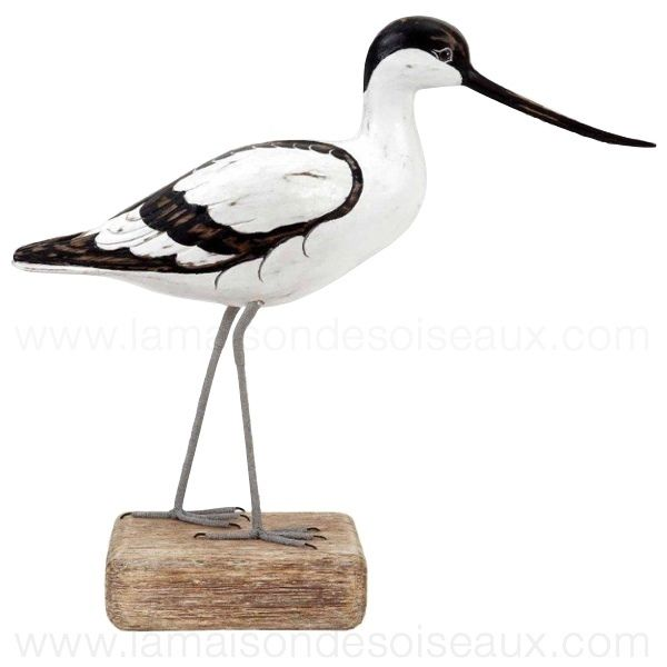 shorebird carvings   Wooden carved avocet posed on a natural wood stand. Hand carved and ...