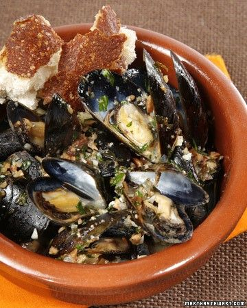 In this recipe, chef Sam Hayward cooks the mussels in the oven. Chopped toasted almonds give the sauce a nutty flavor, while butter makes it silken.