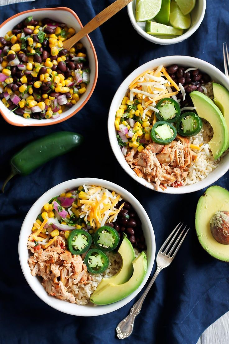 Better than Chipotle DIY Chicken Burrito Bowls that are awesome for clean eating and healthy meal prep. Chicken can be made in the slow cooker for ease!