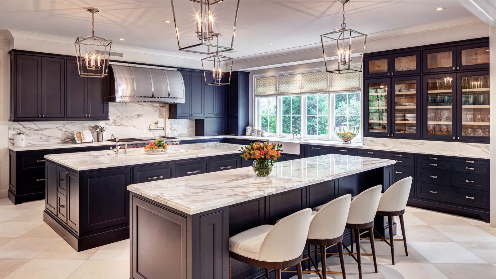 Transitional kitchen with black cabinets; white and gray marble ...