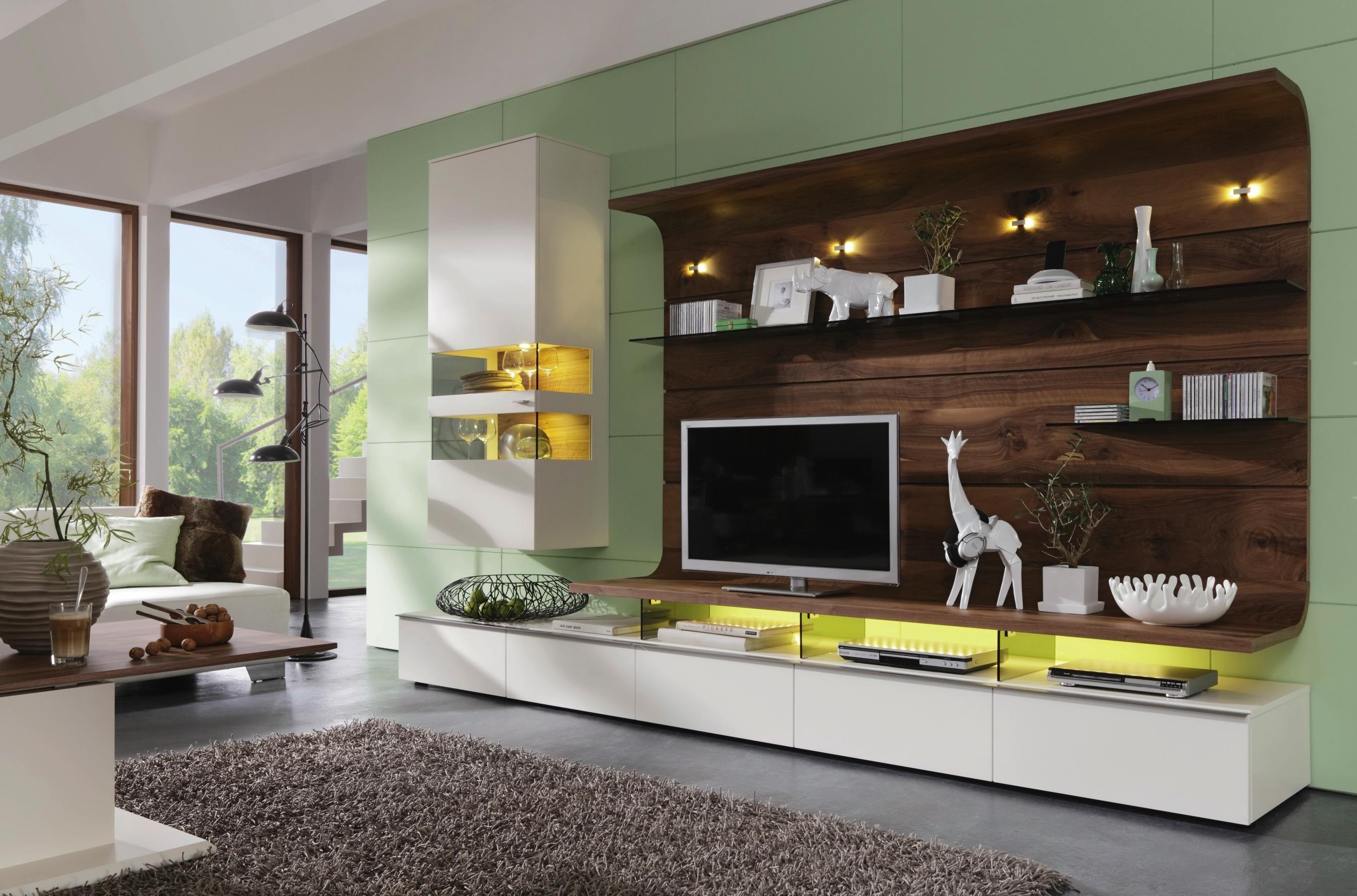 geschmackvolle wohnwand von moderano eleganz mit wei em akzent wohnw nde pinterest. Black Bedroom Furniture Sets. Home Design Ideas