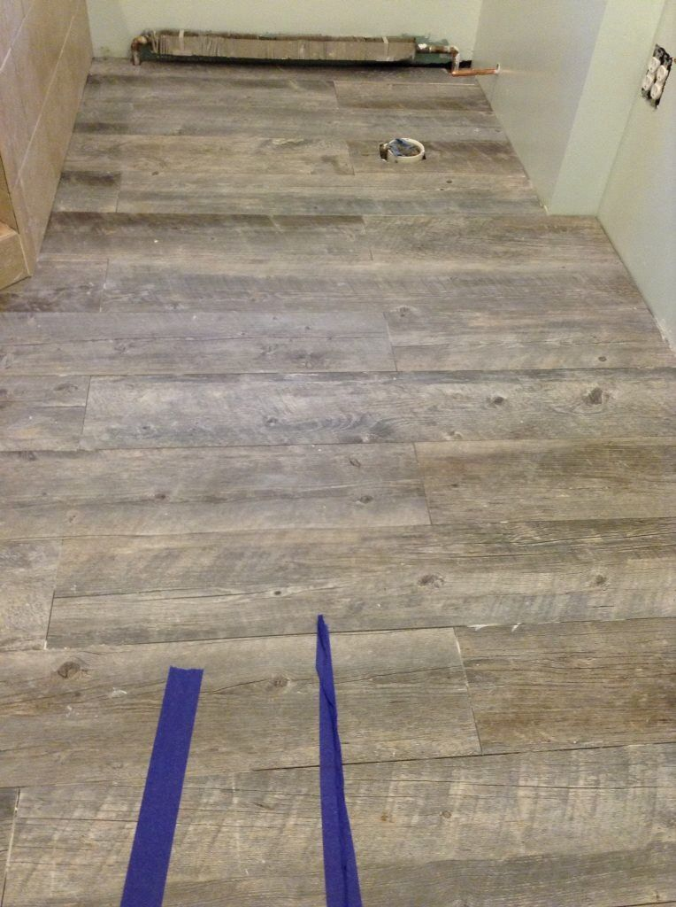 Distressed Driftwood Ceramic Tile Mimicking A Wood Grain Texture You Can Find It At Lowes Flooring Ceramic Floor Ceramic Floor Tile