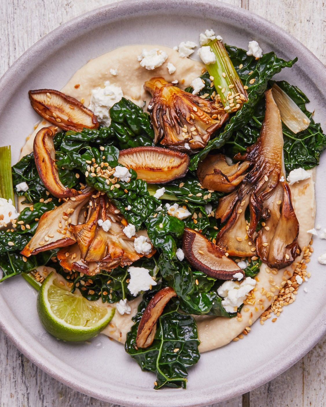 Photo of Crispy Mushrooms With Creamy White Beans and Kale