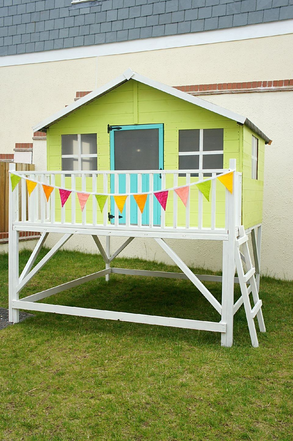 We brought this playhouse kit but painted and decorated it ourselves ...