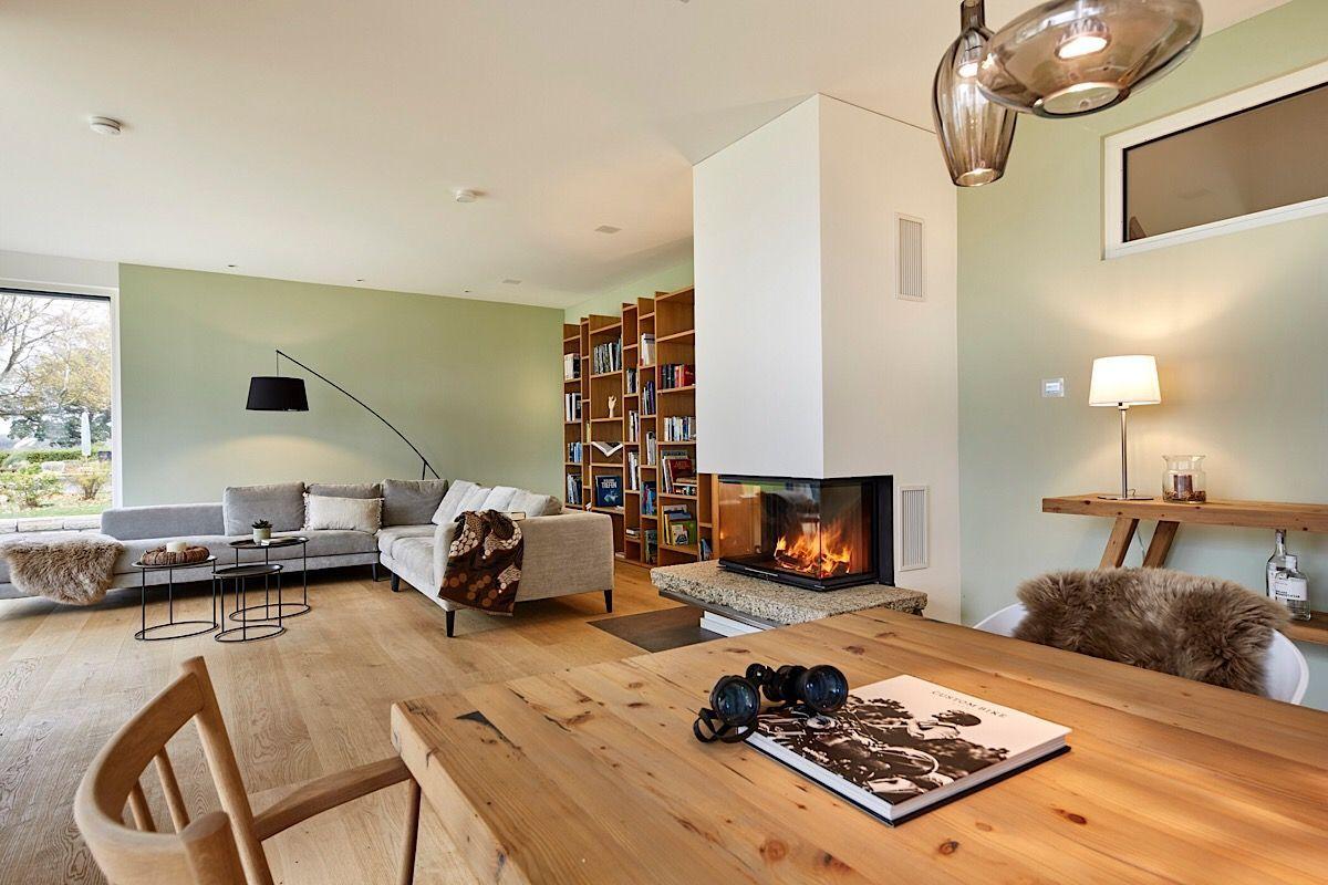 Inneneinrichtung Wohnzimmer Esszimmer modern offen mit Kamin